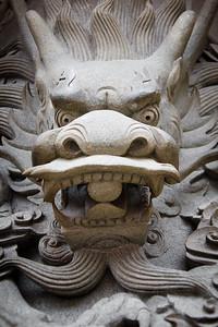 Sculpted stone dragon head.