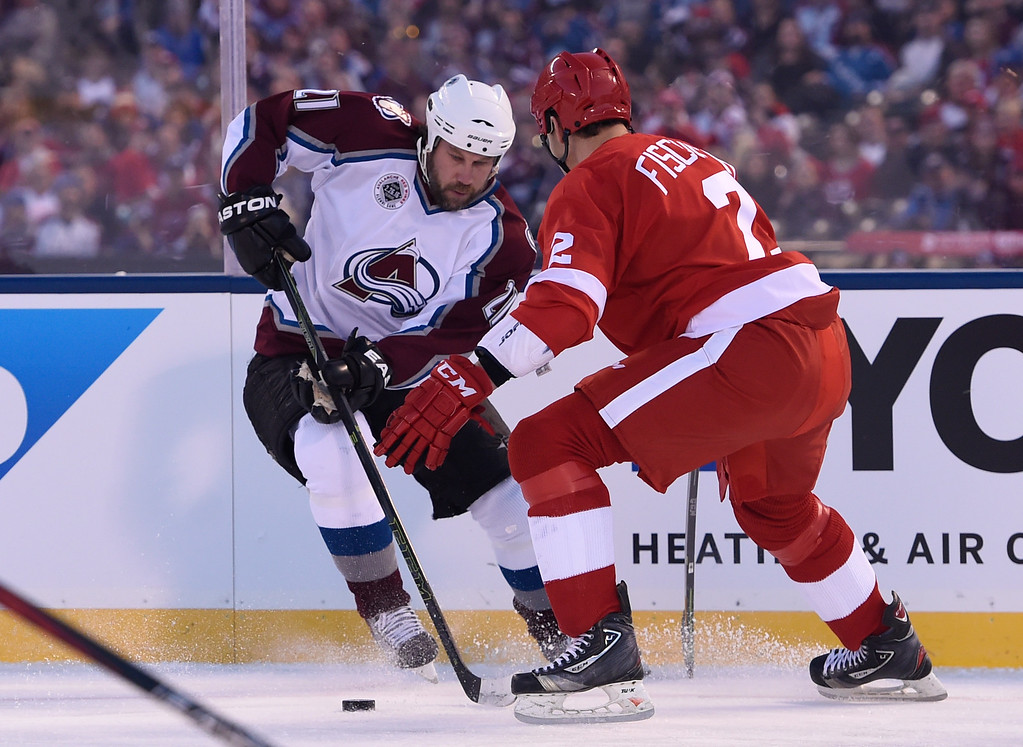 . DENVER, CO - FEBRUARY 26: Colorado Avalanche Peter Forsberg (21) controls the puck in front of Detroit Red Wings Jiri Fischer (2) during the first period February 26, 2016 at Coors Field. (Photo By John Leyba/The Denver Post)