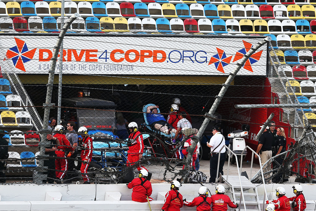 . DAYTONA BEACH, FL - FEBRUARY 23:  Medical personnel remove an injured fan from the stands following an incident at the finish of  the NASCAR Nationwide Series DRIVE4COPD 300 at Daytona International Speedway on February 23, 2013 in Daytona Beach, Florida.  (Photo by Matthew Stockman/Getty Images)