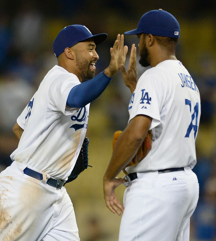 . Matt Kemp congratulates Hanley Jansen after the win. The Dodgers defeated the San Diego Padres 8-6 at Dodger Stadium. Los Angeles, CA. 8/19/2014(Photo by John McCoy Daily News)