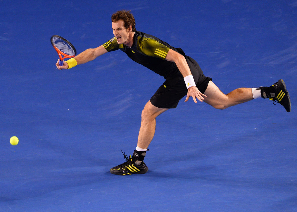 . Britain\'s Andy Murray hits a return against Serbia\'s Novak Djokovic during the men\'s singles final on day 14 of the Australian Open tennis tournament in Melbourne on January 27, 2013.  WILLIAM WEST/AFP/Getty Images