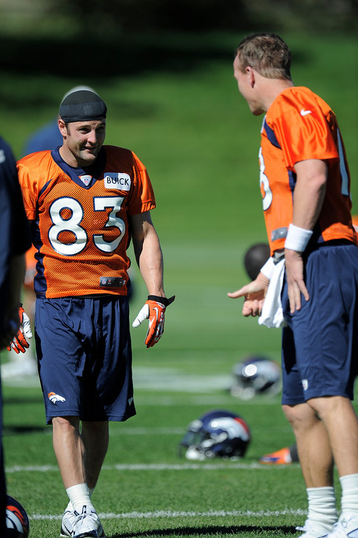 . Wide receiver Wes Welker (83) of the Denver Broncos talks with quarterback Peyton Manning (18) of the Denver Broncos before practice September 25, 2013 at Dove Valley. (Photo by John Leyba/The Denver Post)