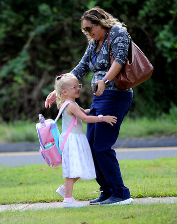 8/28/2019 Mike Orazzi | Staff Amy Swiatlon greets her daughter Quinn,4, on the first day back to school at the Plymouth Center School on Wednesday morning.