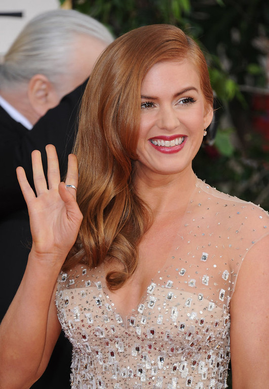 . Actress Isla Fisher arrives at the 70th Annual Golden Globe Awards at the Beverly Hilton Hotel on Sunday Jan. 13, 2013, in Beverly Hills, Calif. (Photo by Jordan Strauss/Invision/AP)