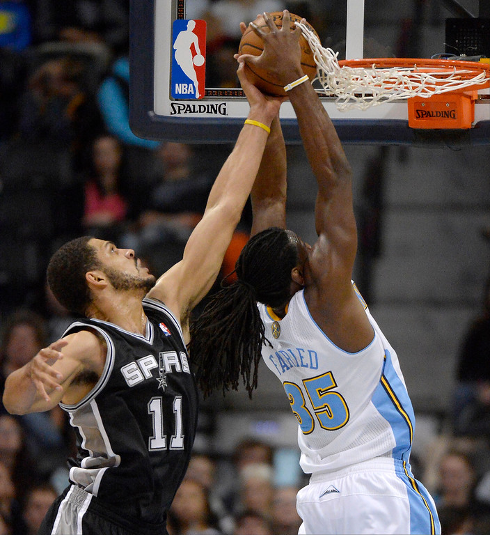 . DENVER, CO - OCTOBER 14: Denver Nuggets small forward Kenneth Faried (35) hauls down a rebound from San Antonio Spurs power forward Jeff Ayres (11) October 14, 2013 at Pepsi Center. (Photo By John Leyba/The Denver Post)