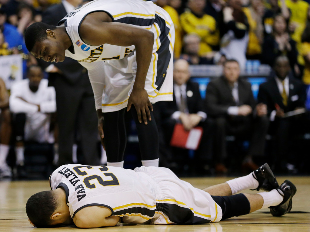 . Wichita State forward Cleanthony Early (11) checks on guard Fred VanVleet (23) during the second half of a third-round game against Kentucky at the NCAA college basketball tournament Sunday, March 23, 2014, in St. Louis. (AP Photo/Jeff Roberson)