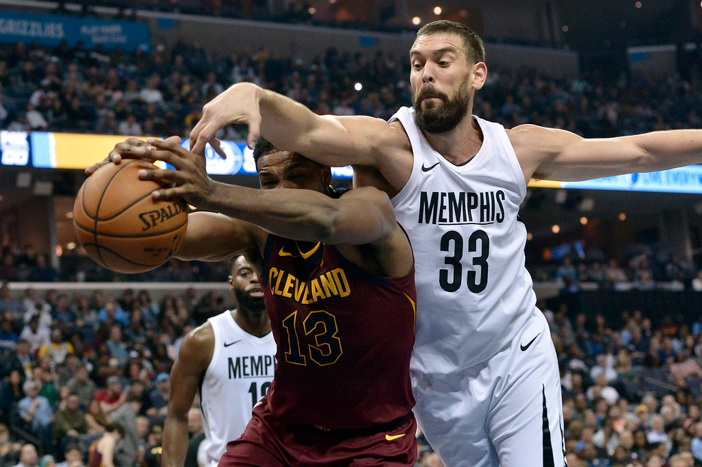 . Cleveland Cavaliers center Tristan Thompson (13) and Memphis Grizzlies center Marc Gasol (33) struggle for control of the ball during the first half of an NBA basketball game Friday, Feb. 23, 2018, in Memphis, Tenn. (AP Photo/Brandon Dill)