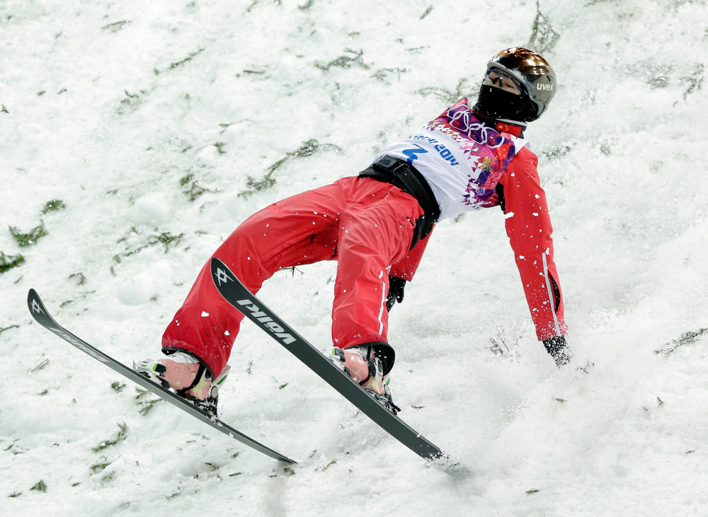 . China\'s Xu Mengtao lands from her final jump in the women\'s freestyle skiing aerials final at the Rosa Khutor Extreme Park, at the 2014 Winter Olympics, Friday, Feb. 14, 2014, in Krasnaya Polyana, Russia. (AP Photo/Andy Wong)