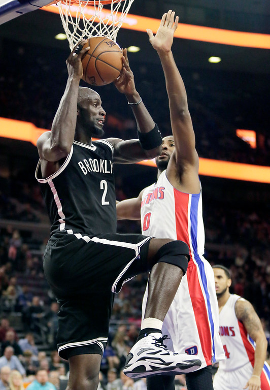 . Brookyn Nets\' Kevin Garnett (2) looks to pass the ball against the defense from Detroit Pistons\' Andre Drummond (0) during the first half of an NBA basketball game Saturday, Nov. 1, 2014, in Auburn Hills, Mich. (AP Photo/Duane Burleson)