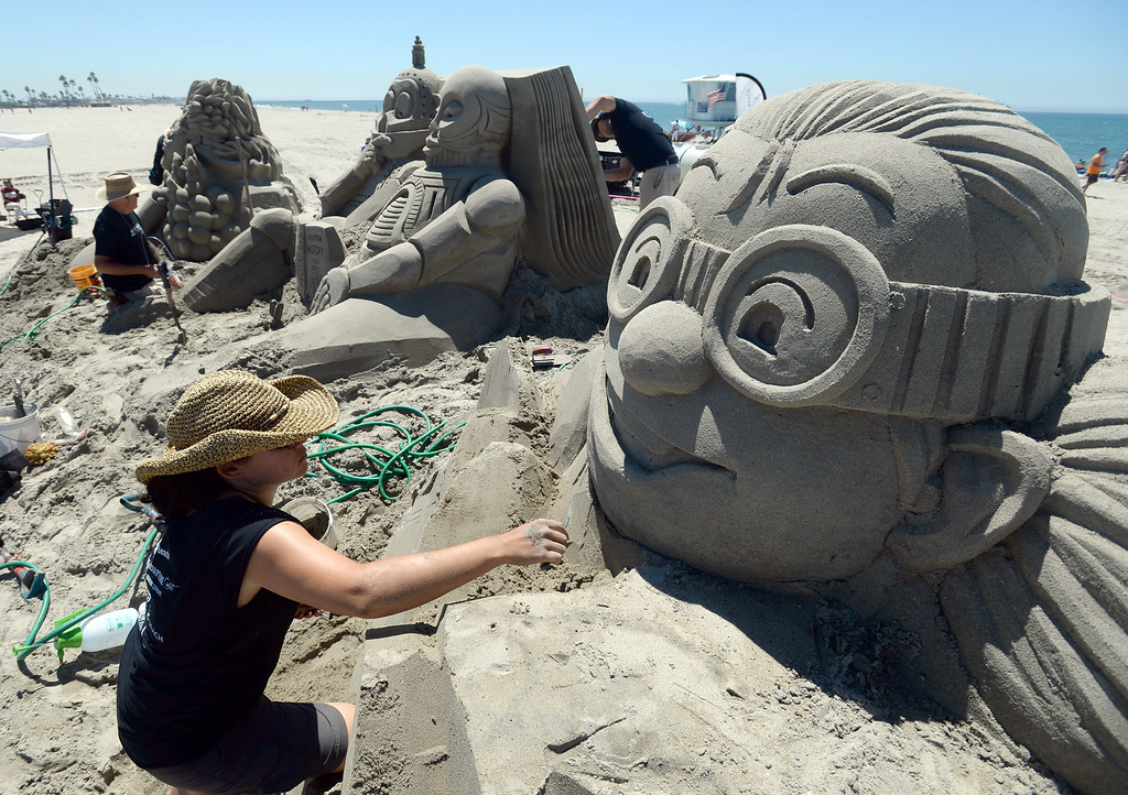 . Artists took to the beach at Belmont Shore for the 82nd Annual Sand Sculpture Contest Saturday, August 16, 2014, Long Beach, CA.  Sue McGrew nears completion of the face of her sculpture. Photo by Steve McCrank/Daily Breeze