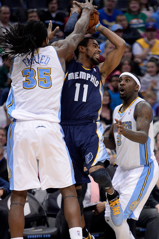 . Denver Nuggets forward Kenneth Faried (35) and guard Ty Lawson (3) defend Memphis Grizzlies guard Mike Conley (11)  during the third quarter of action. (Photo by AAron Ontiveroz/The Denver Post)