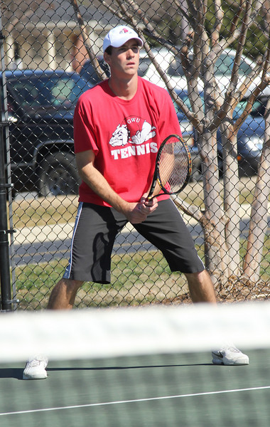 Andrew Carter awaits a serve from his opponent in a doubles' match win against Anderson.