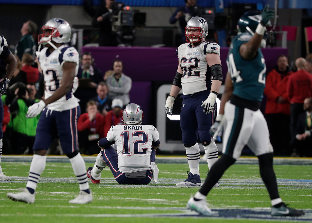. New England Patriots quarterback Tom Brady (12) pauses after fumbling the ball, during the second half of the NFL Super Bowl 52 football game against the Philadelphia Eagles, Sunday, Feb. 4, 2018, in Minneapolis. (AP Photo/Tony Gutierrez)