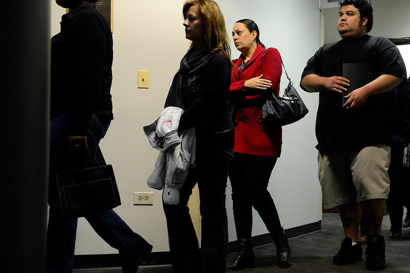 . People arrive following a break in the hearing for James Holmes at the Arapahoe County Justice Center on Tuesday, January 8, 2012. AAron Ontiveroz, The Denver Post
