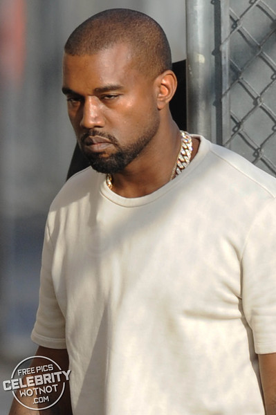 Kanye West Shows Off Arm Tattoos Holding A Louis Vuitton Bag