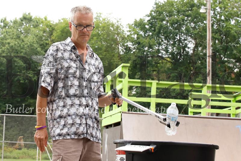 Tony Frochio picks up trash at Father Marinaro Park. Seb Foltz/Butler Eagle