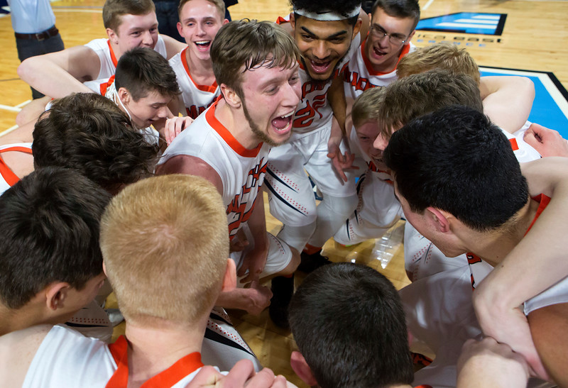 BANGOR, Maine -- 03/04/2017 -- Machias' James Mersereau (center) celebrates with his team after defeating Greenville during their Class D boys basketball state championship at the Cross Insurance Center in Bangor Saturday. Ashley L. Conti | BDN