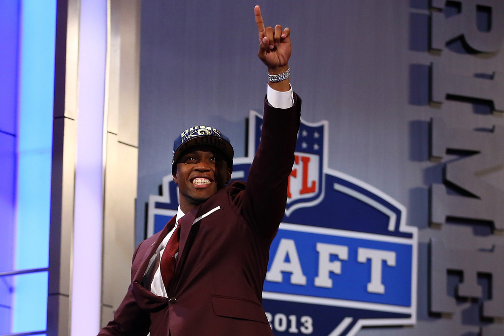 . NEW YORK, NY - APRIL 25:  Tavon Austin (R) of West Virginia Mountaineers reacts after Austin was picked #8 overall by the St. Louis Rams in the first round of the 2013 NFL Draft at Radio City Music Hall on April 25, 2013 in New York City.  (Photo by Al Bello/Getty Images)