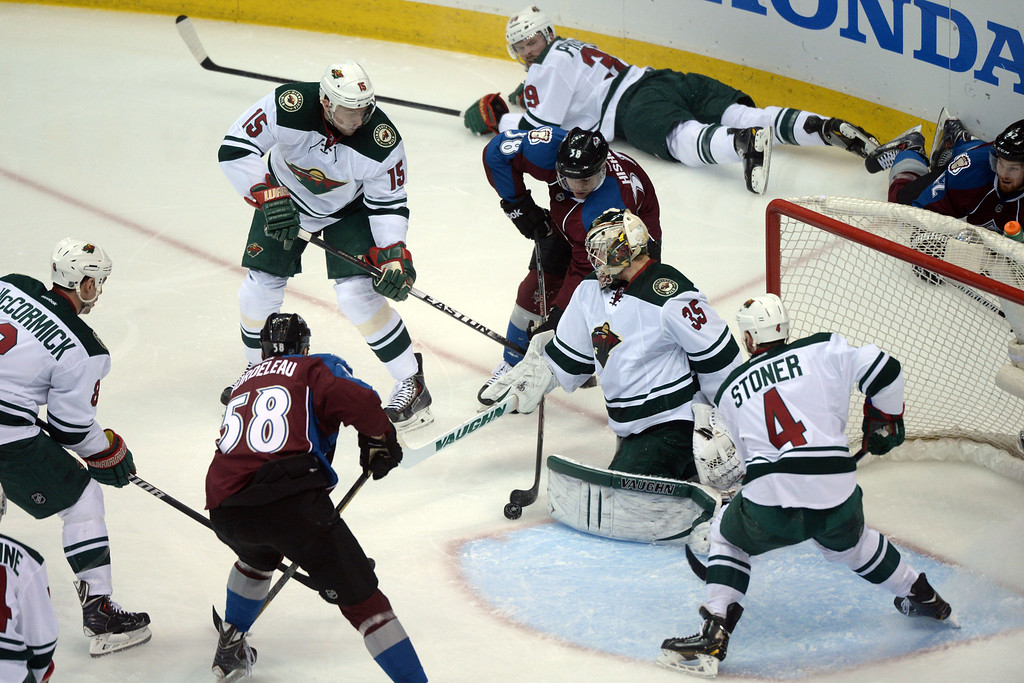 . DENVER, CO - APRIL 26: Joey Hishon (38) of the Colorado Avalanche looks for a shot near the goal among the chaos of play as Darcy Kuemper (35) of the Minnesota Wild tends the net during the second period. The Colorado Avalanche hosted the Minnesota Wild during game five of the first round of the NHL Stanley Cup Playoffs at the Pepsi Center on Saturday, April 26, 2014. (Photo by Karl Gehring/The Denver Post)