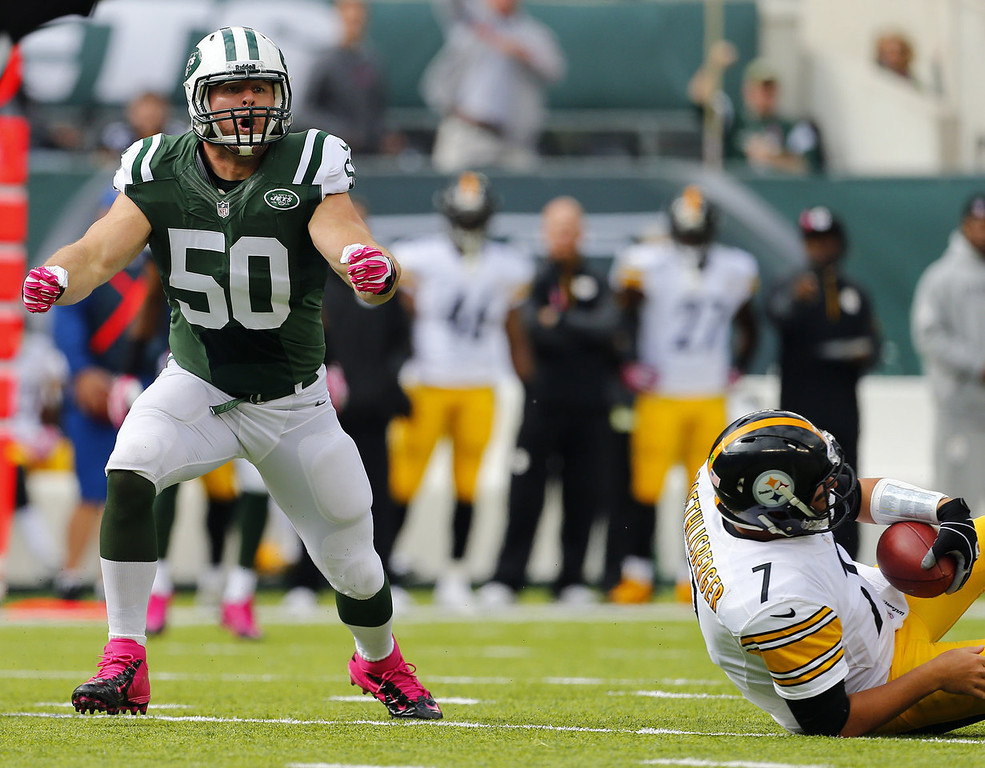 . Linebacker Garrett McIntyre #50 of the New York Jets reacts after sacking quarterback Ben Roethlisberger #7 of the Pittsburgh Steelers in the second quarter during a game at MetLife Stadium on October 13, 2013 in East Rutherford, New Jersey. (Photo by Rich Schultz /Getty Images)