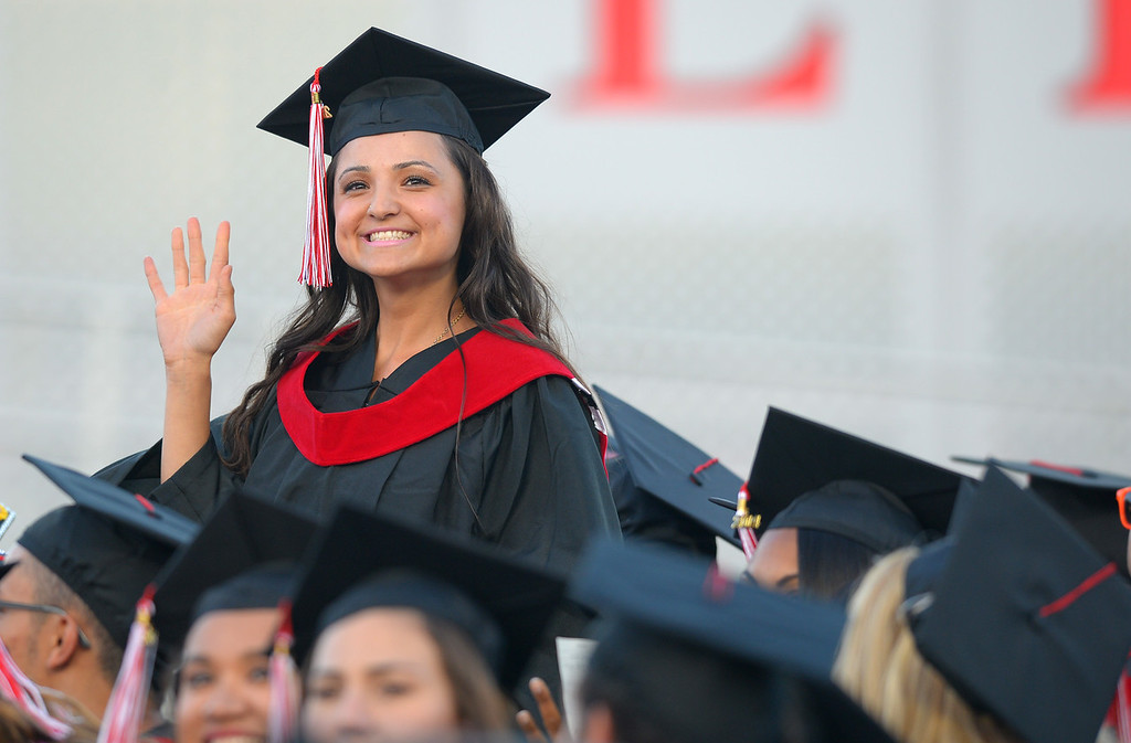 . A Long Beach City College graduate smiles to family in the grandstand prior to receiving her degree at Veterans Memorial Stadium in Long Beach, CA on Thursday, June 5, 2014. (Photo by Scott Varley, Daily Breeze)