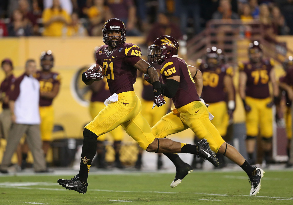 . TEMPE, AZ - OCTOBER 12:  Wide receiver Jaelen Strong #21 of the Arizona State Sun Devils runs with the football en route to scoring on a 69 yard touchdown reception against the Colorado Buffaloes during the first quarter of the college football game at Sun Devil Stadium on October 12, 2013 in Tempe, Arizona.  (Photo by Christian Petersen/Getty Images)