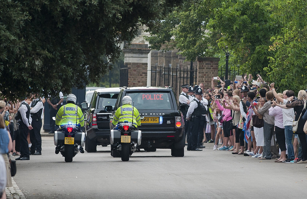 . Prince William drives Catherine, Duchess of Cambridge and their new-born baby boy back to Kensington Palace in London on July 23, 2013. The baby was born on Monday afternoon weighing eight pounds six ounces. The royal couple have led a relatively simple married life until now at a farmhouse in Wales close to William\'s airbase, though after the birth they will move into London\'s Kensington Palace, which has been refurbished at a cost of £1 million of British taxpayers\' money.  WILL OLIVER/AFP/Getty Images