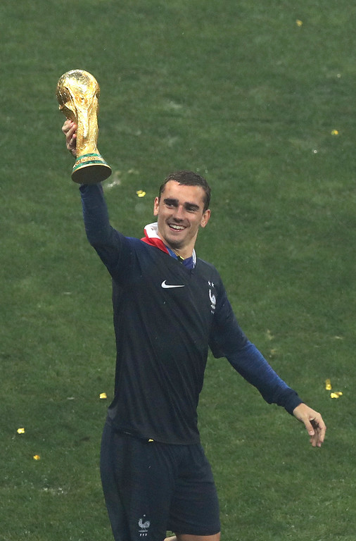 . France\'s Antoine Griezmann celebrates with the trophy at the end of the final match between France and Croatia at the 2018 soccer World Cup in the Luzhniki Stadium in Moscow, Russia, Sunday, July 15, 2018. (AP Photo/Thanassis Stavrakis)