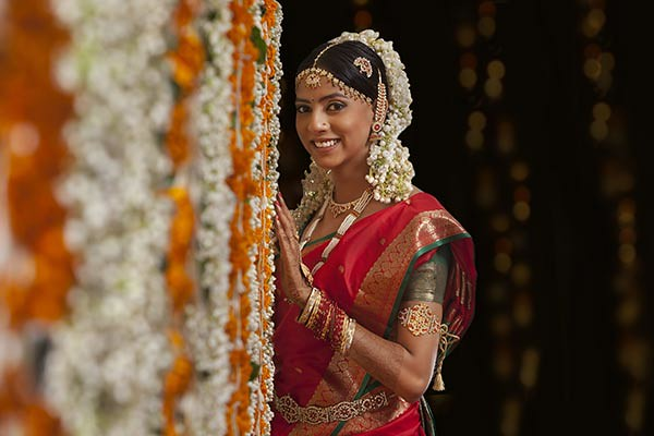 Bride-standing-by-garlands.jpg
