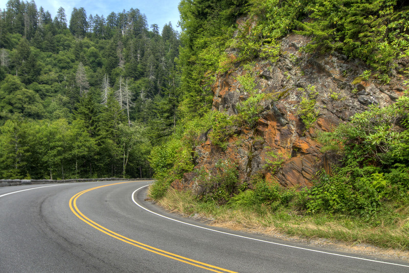 A bend in the road around an exposed rocky corner at the Great Smoky Mountains National Park in Gatlinburg, TN on Sunday, August 4, 2013. Copyright 2013 Jason Barnette