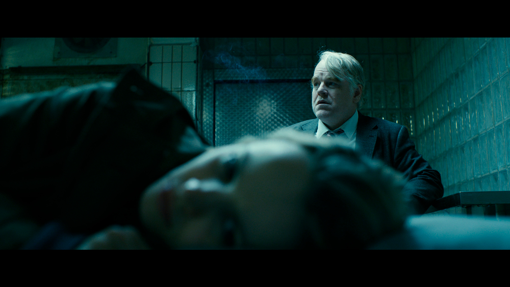 ". This photo provided by the Sundance Institute shows Philip Seymour Hoffman, right, and Rachel McAdams, front, in a scene from the film, ""A Most Wanted Man,\"" which premiered at the 2014 Sundance Film Festival. After appearing in over 50 movies, 46-year-old Hoffman says working on �A Most Wanted Man� was one of the most satisfying movie-making experiences he�s had. (AP Photo/Sundance Institute)"