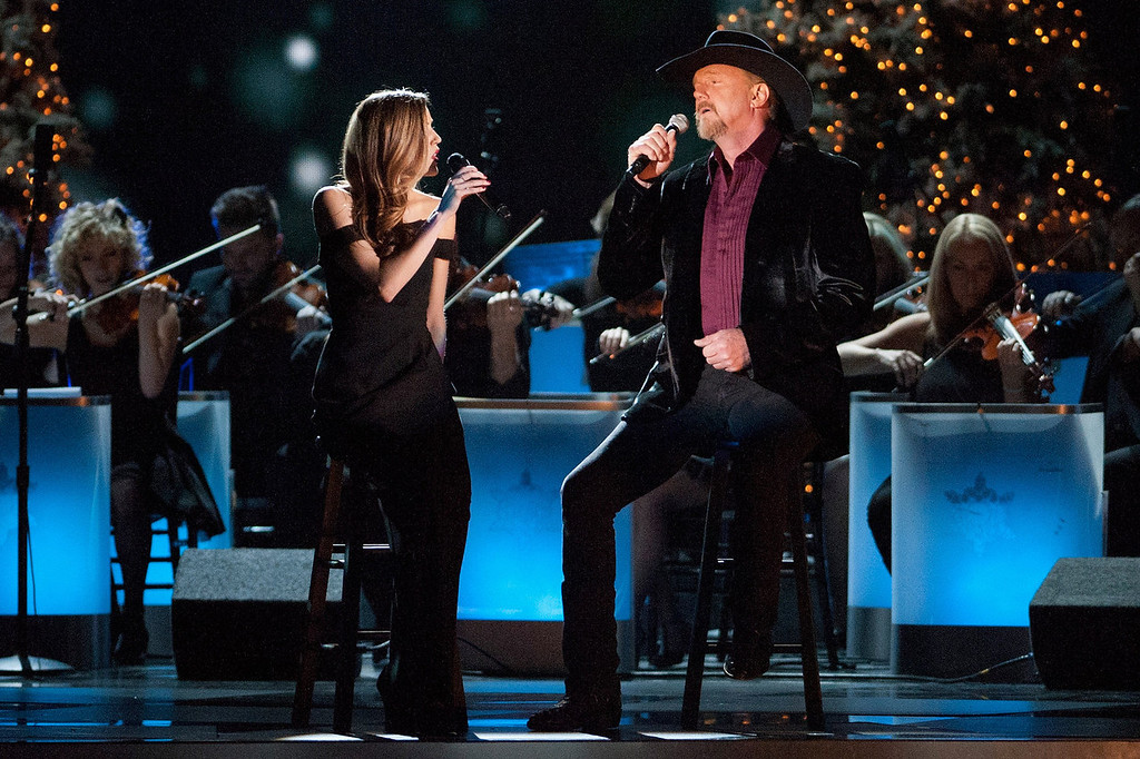 . Lily Costner and Trace Adkins perform during the CMA 2013 Country Christmas on November 8, 2013 in Nashville, Tennessee.  (Photo by Erika Goldring/Getty Images)