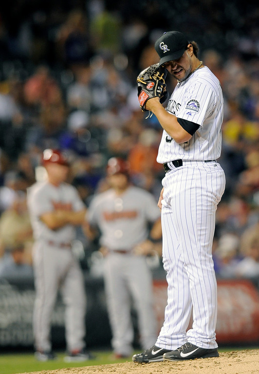 . Colorado Rockies relief pitcher Tommy Kahnle reacts after walking in a run in the sixth inning of a baseball game against the Arizona Diamondbacks, Thursday, Sept. 18, 2014, in Denver. (AP Photo/Chris Schneider)