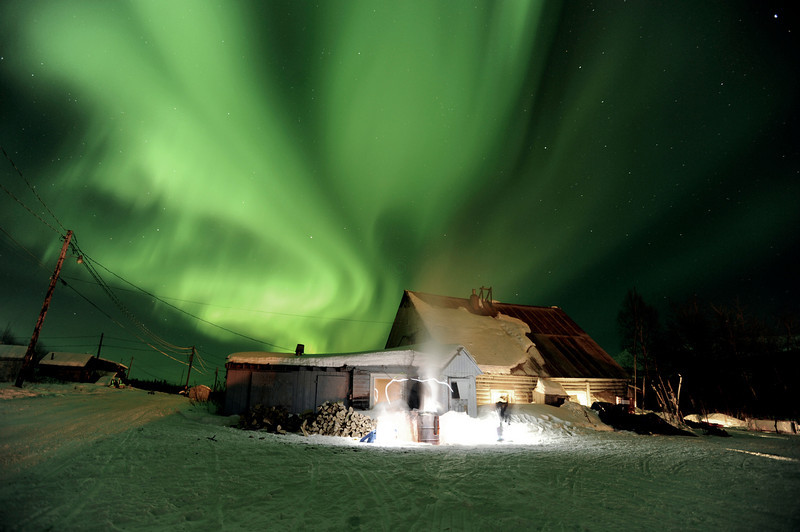 . The aurora borealis, or northern lights, fill the sky above the Takotna, Alaska  checkpoint during the Iditarod Trail Sled Dog Race on Wednesday, March 9, 2011.   (AP Photo/The Anchorage Daily News, Bob Hallinen, File)