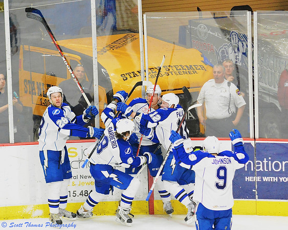 Syracuse Crunch players celebrate Richard Panik's  (14) overtime goal against the Portland Pirates in American Hockey League (AHL) Calder Cup playoff action at the Onondaga County War Memorial on Saturday, April 27, 2013.