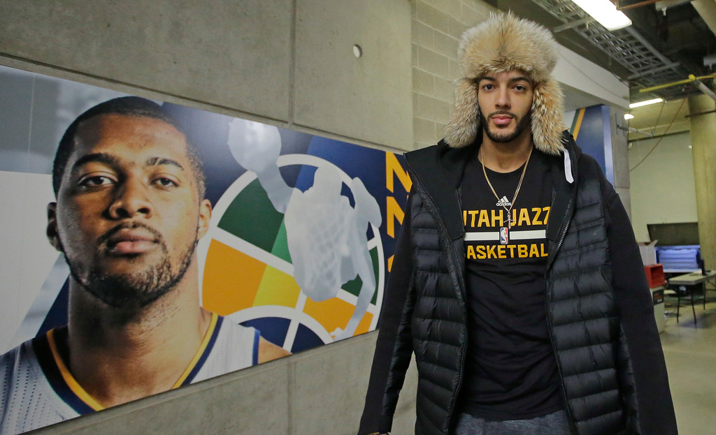 . Utah Jazz center Rudy Gobert (27) arrives before the start of their NBA basketball game against the Cleveland Cavaliers Tuesday, Jan. 10, 2017, in Salt Lake City. (AP Photo/Rick Bowmer)