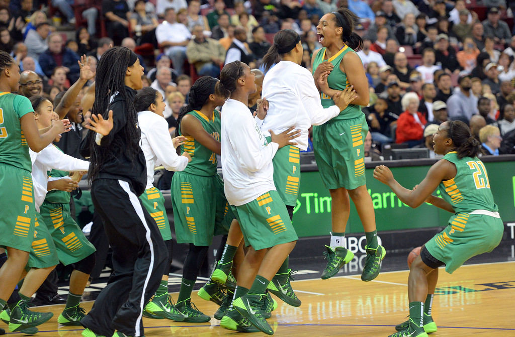 . Poly players rush to celebrate after beating Salesian at Sleep Train Arena in Sacramento, CA on Saturday, March 29, 2014. Long Beach Poly vs Salesian in the CIF Open Div girls basketball state final. 2nd half. Poly won 70-52. (Photo by Scott Varley, Daily Breeze)