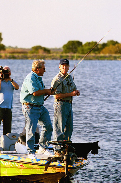 . President Bush appears with with Roland Martin on Martin\'s fishing show for the Outdoor Life Network, in this April 2004 photo. The episode, taped at a lake on the president\'s Crawford, Texas ranch, aired  Aug.  6, 2004. Bush\'s dog, Barney, lower right, also made an cameo appearance. (AP Photo/White House via Outdoor Life Network, Eric Draper)