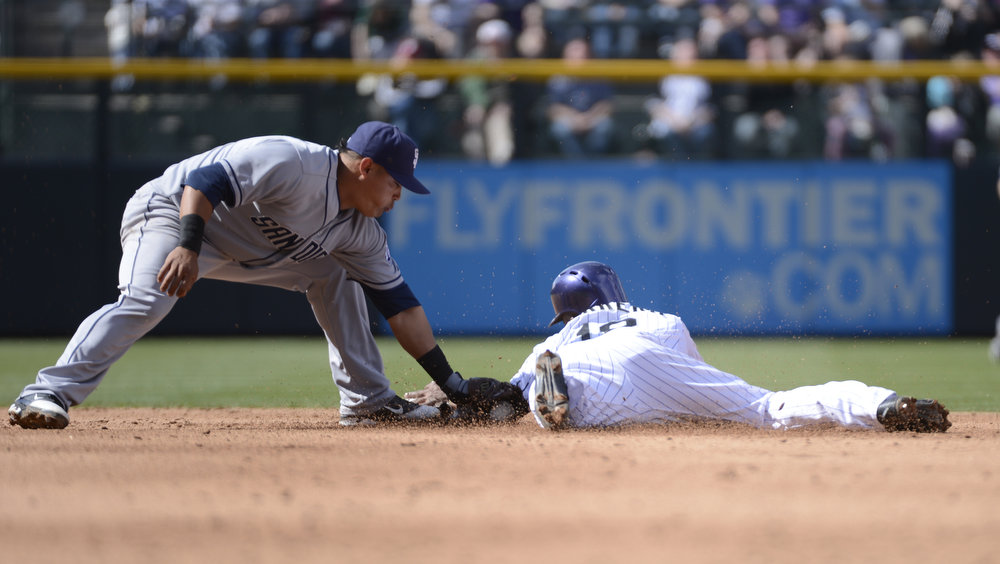 . Colorado Rockies Jonathan Herrera (18) gets tagged out attempting to steal second base by San Diego Padres Everth Cabrera (2) in the fourth inning April 7, 2013 at Coors Field. (Photo By John Leyba/The Denver Post)