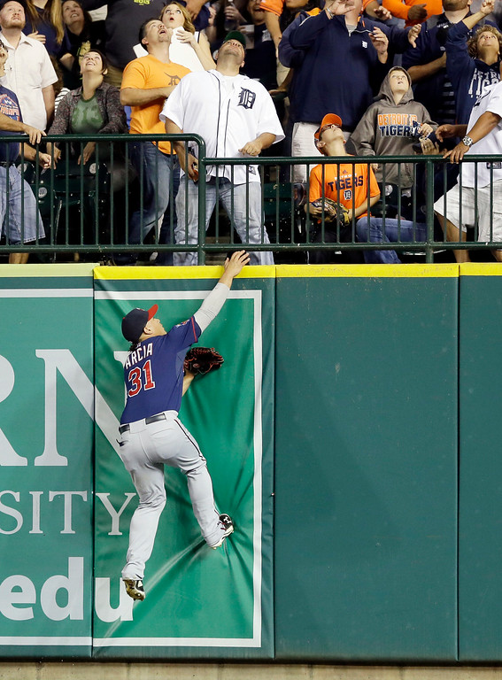 . Minnesota Twins right fielder Oswaldo Arcia (31) jumps but can\'t reach as a solo home run by Detroit Tigers\' Nick Castellanos clears the wall during the second inning of a baseball game in Detroit, Saturday, Sept. 27, 2014. (AP Photo/Carlos Osorio)