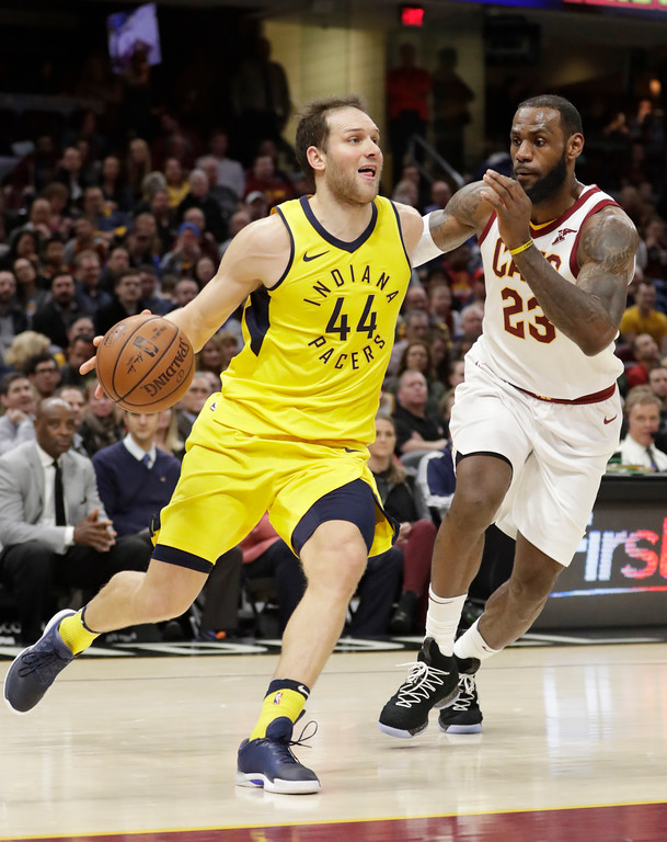 . Indiana Pacers\' Bojan Bogdanovic (44), from Croatia, drives against Cleveland Cavaliers\' LeBron James (23) in the second half of an NBA basketball game, Friday, Jan. 26, 2018, in Cleveland. (AP Photo/Tony Dejak)