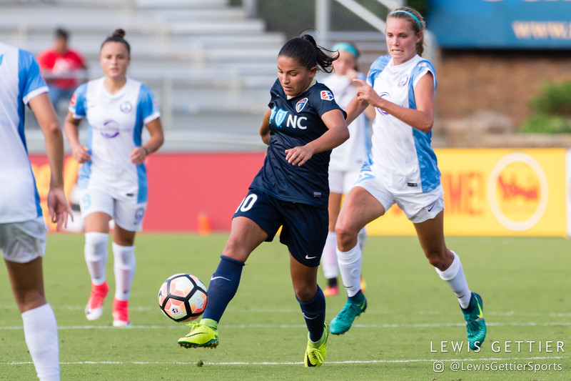 Debinha (10) and Dani Weatherholt (17) during a match between the NC Courage and the Orlando Pride in Cary, NC in Week 3 of the 2017 NWSL season. Photo by Lewis Gettier.