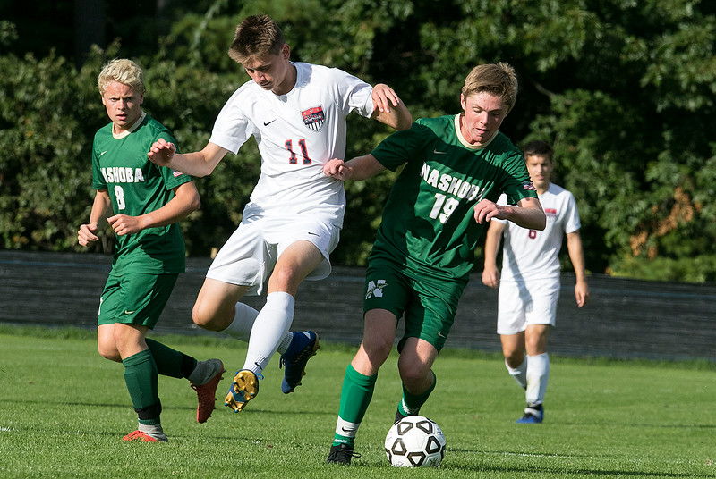 Nashoba Regional High School played North Middlesex Regional High School on Tuesday, September 17, 2019. NMRHS's Jake Richard and NRHS's #19 Michael White. SENTINEL & ENTERPRISE/JOHN LOVE