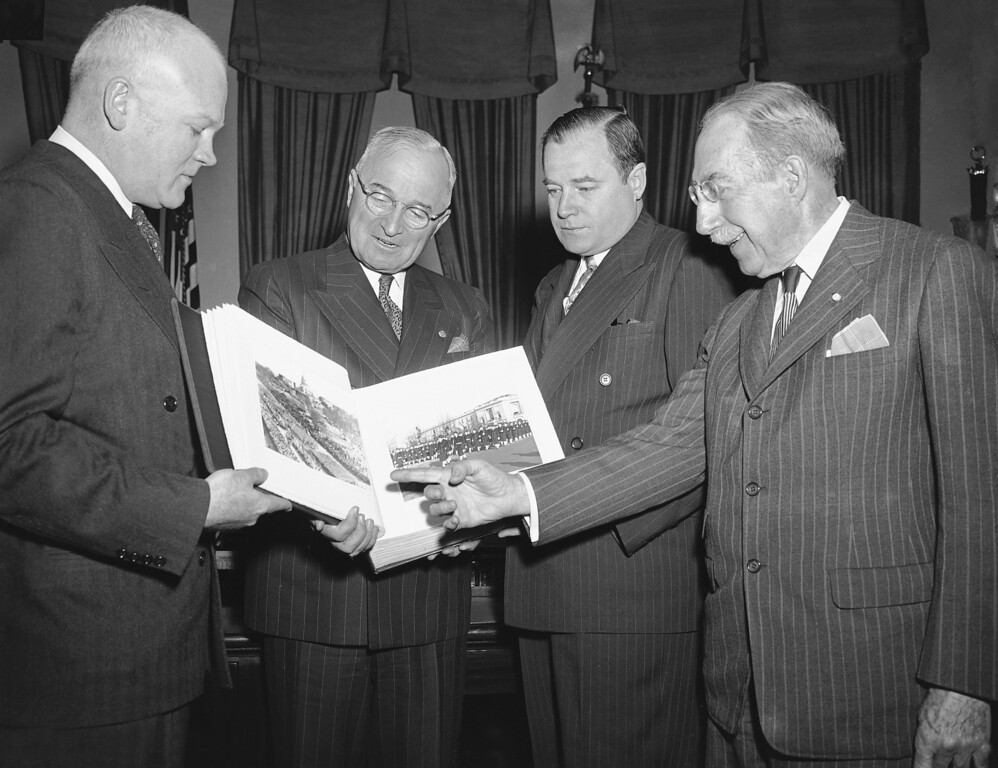 . In this photo, Harry S. Truman looks at a photo album. (AP)
