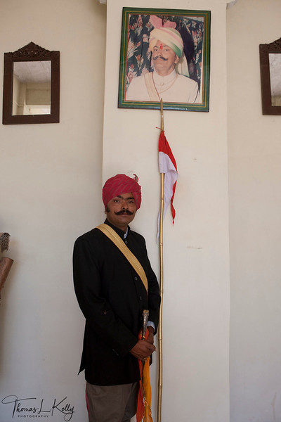 Ajit Singh with his late father's portrait.