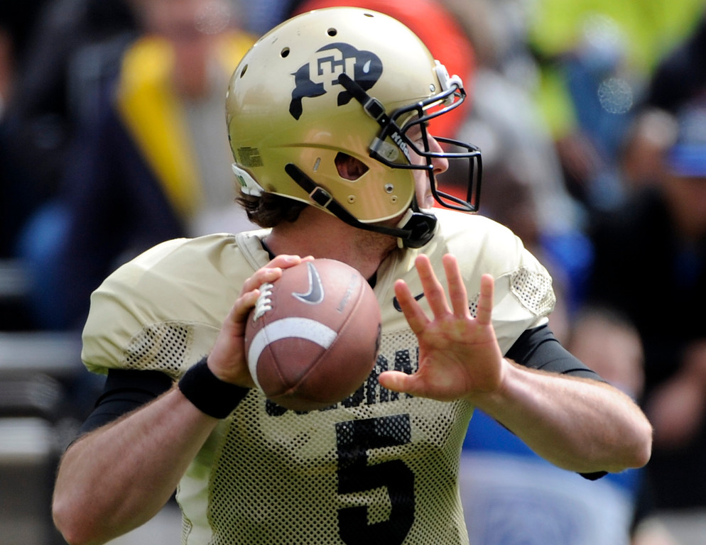 . BOULDER, CO.- APRIL13: Black QB Connor Wood steps back for a pass. The University of Colorado football team hosts its spring football game at Folsom Field under the direction of new head coach Mike Macintyre. (Photo By Kathryn Scott Osler/The Denver Post)
