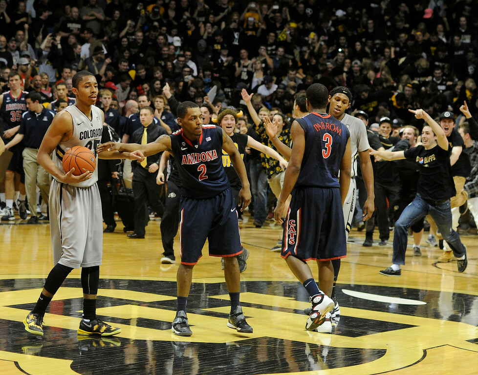 . BOULDER, CO. - FEBRUARY 14: Buffs fans liked the taste of revenge as they rushed the court at the end of the game. The University of Colorado men\'s basketball team defeated Arizona 71-58 Thursday night, February 14, 2013 at the Coors Event Center in Boulder. (Photo By Karl Gehring/The Denver Post)