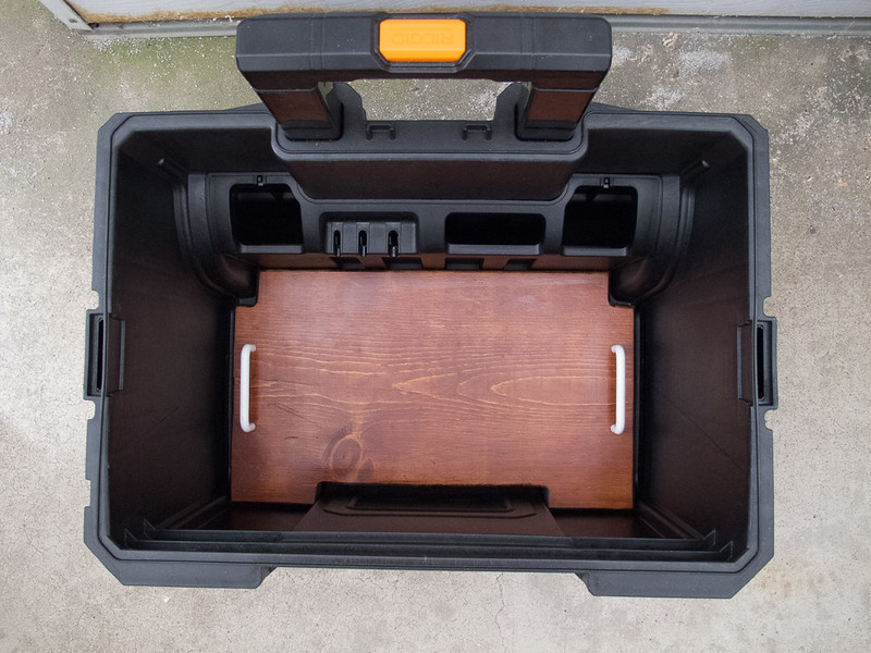 A board was fitted to the bottom of the case to provide a mounting surface for the battery and charger.