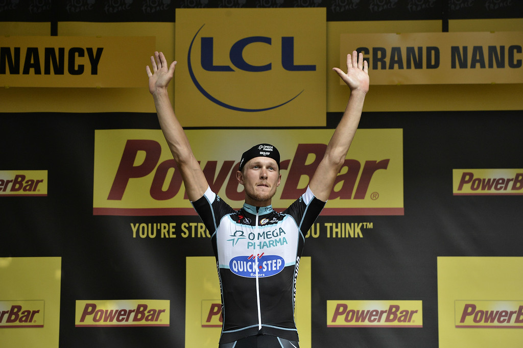 . Stage winner Italy\'s Matteo Trentin celebrates on the podium after winning the 234.5 km seventh stage of the 101st edition of the Tour de France cycling race on July 11, 2014 between Epernay and Nancy, northeastern France.   AFP PHOTO / JEFF PACHOUD/AFP/Getty Images