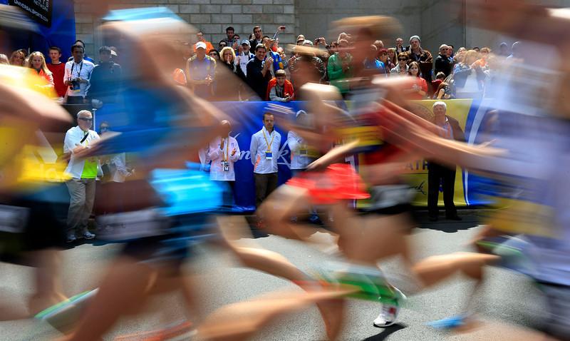 . Spectators cheer runners in the Invitational Mile on Saturday, April 19, 2014, in Boston, in advance of Monday\'s 118th Boston Marathon. (AP Photo/Matt Rourke)